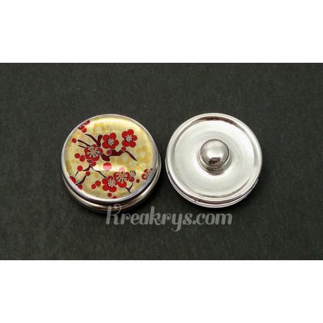 Bouton pression sakura rouge sur fond beige