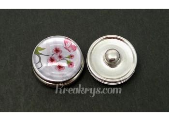 Bouton pression fleur et papillon rose