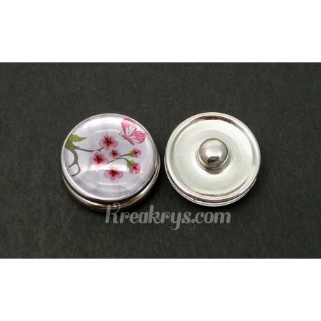 Bouton pression fleurs et papillon rose