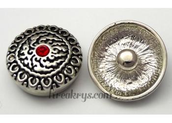 Bouton pression métal argenté avec strass rouge