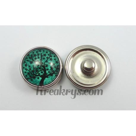 Bouton pression Arbre noir fond couleur turquoise feuille étoilée