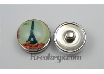 Bouton pression Tour Eiffel avec un parterre de fleurs