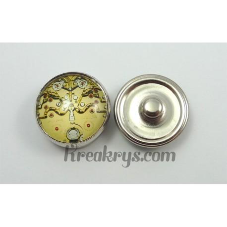 Bouton pression système d'engrenages dorés