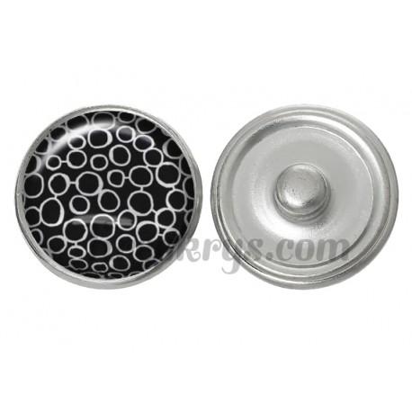 Bouton pression verre cercles blanc sur fond noir